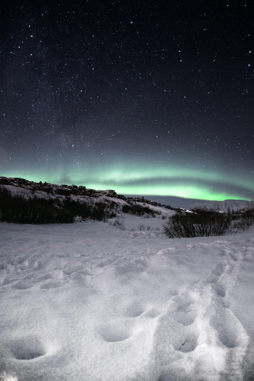 footprints on snow field during night