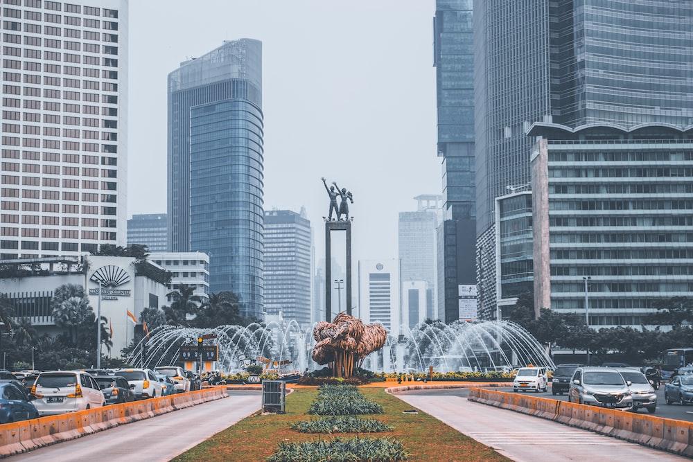 park with fountain near buildings