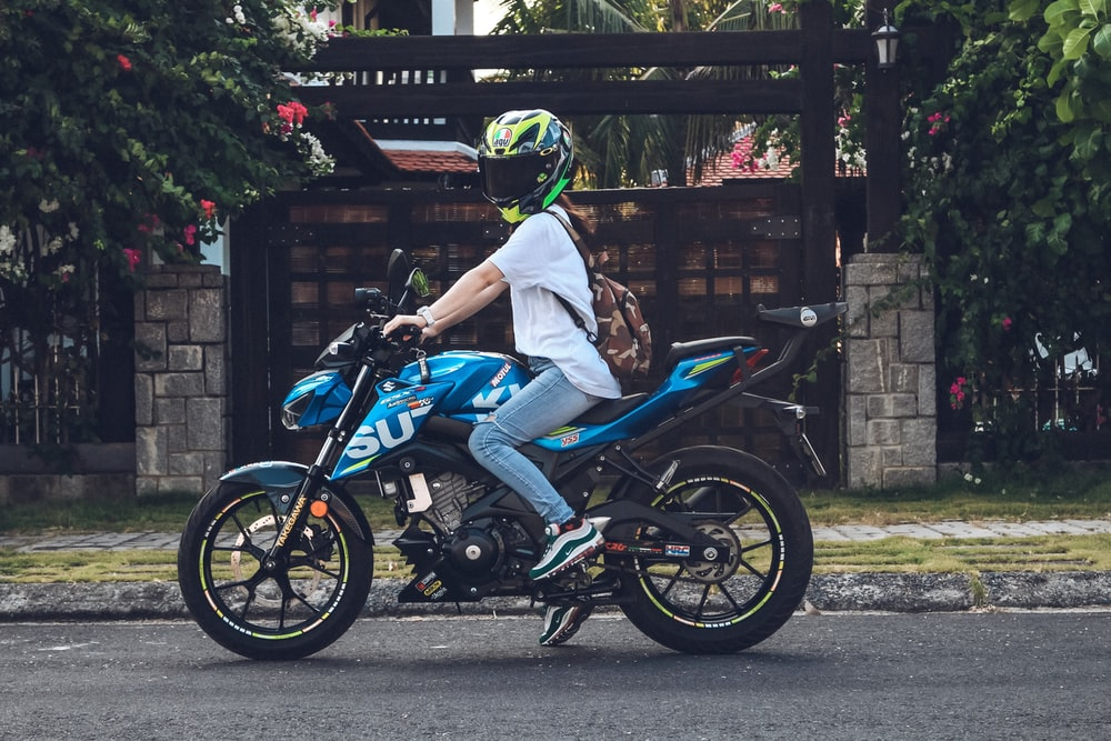 person riding on blue sports bike