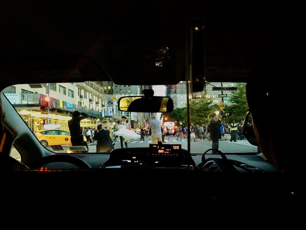 men on street through car's windshield