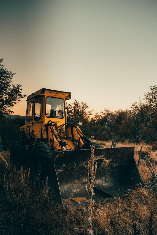 yellow bulldozer on field