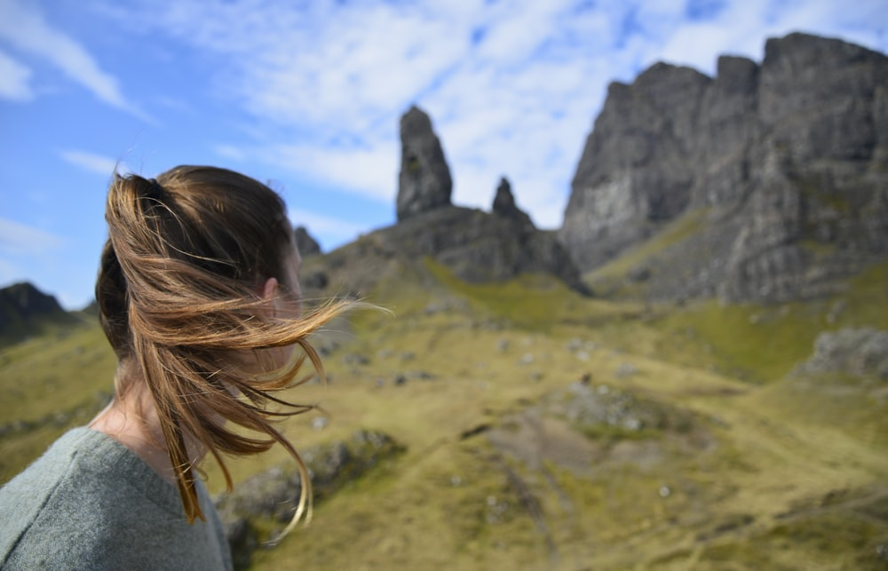 woman looking on rock formation