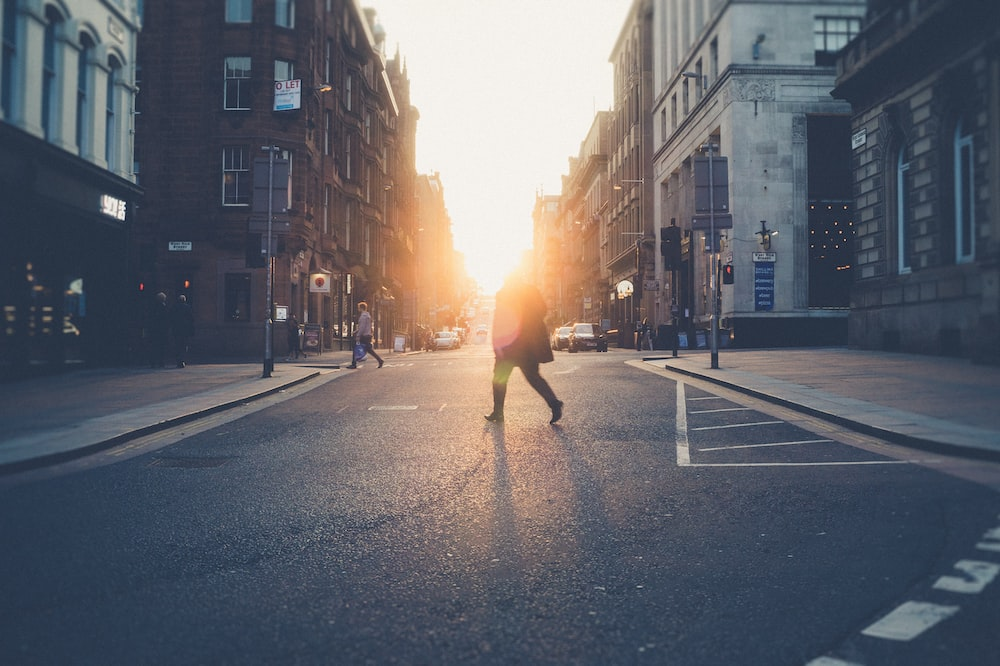 person across road during golden hour