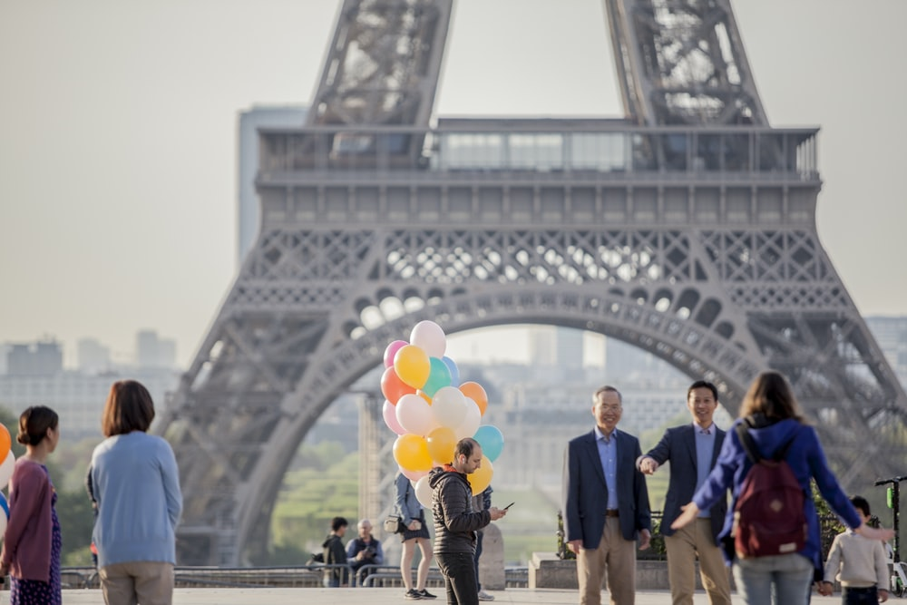 people standing near the Eiffel Tower during daytime
