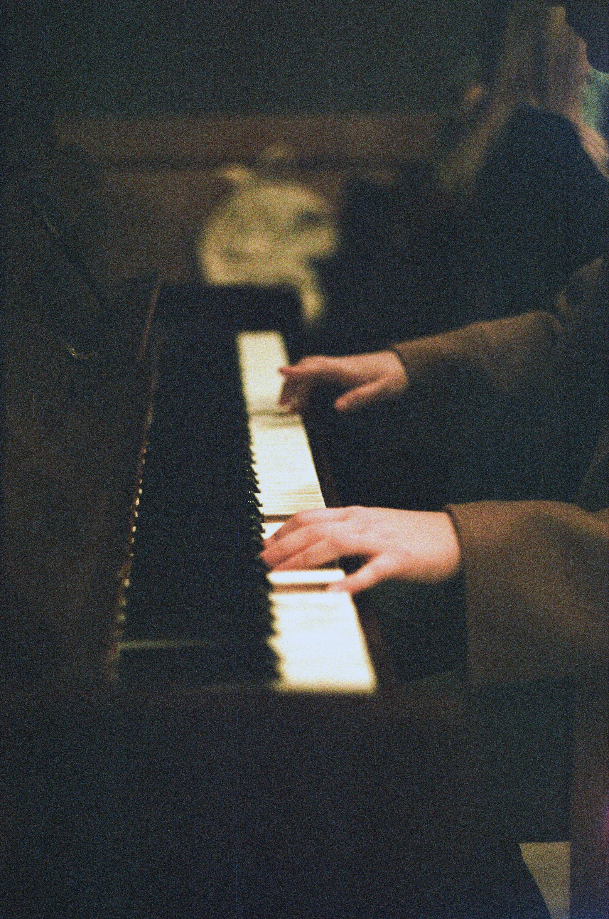 person about to play white and black piano