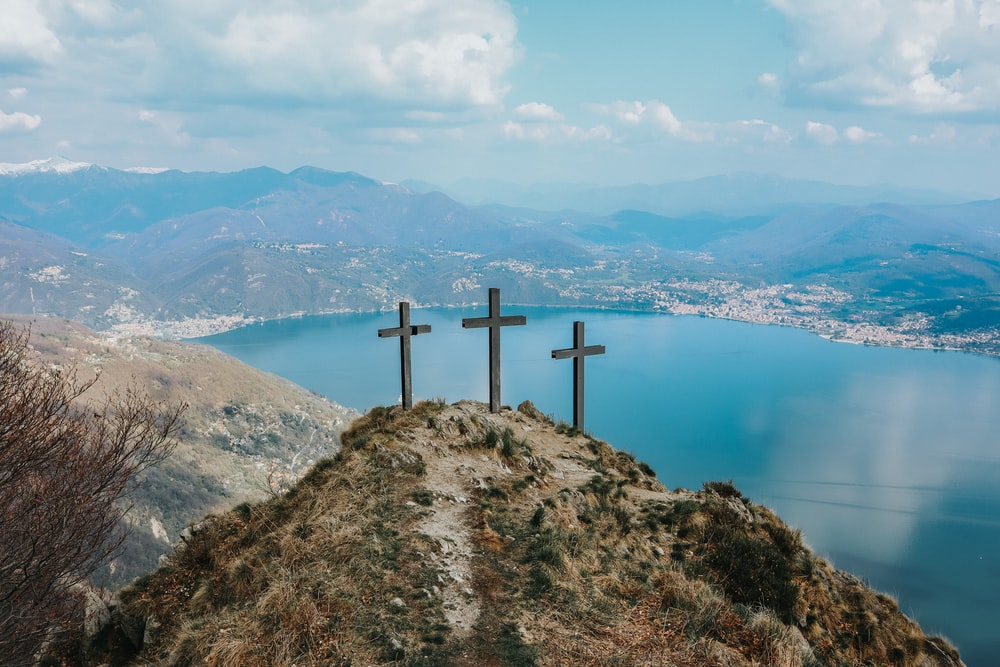 3 wooden cross on top of the mountain