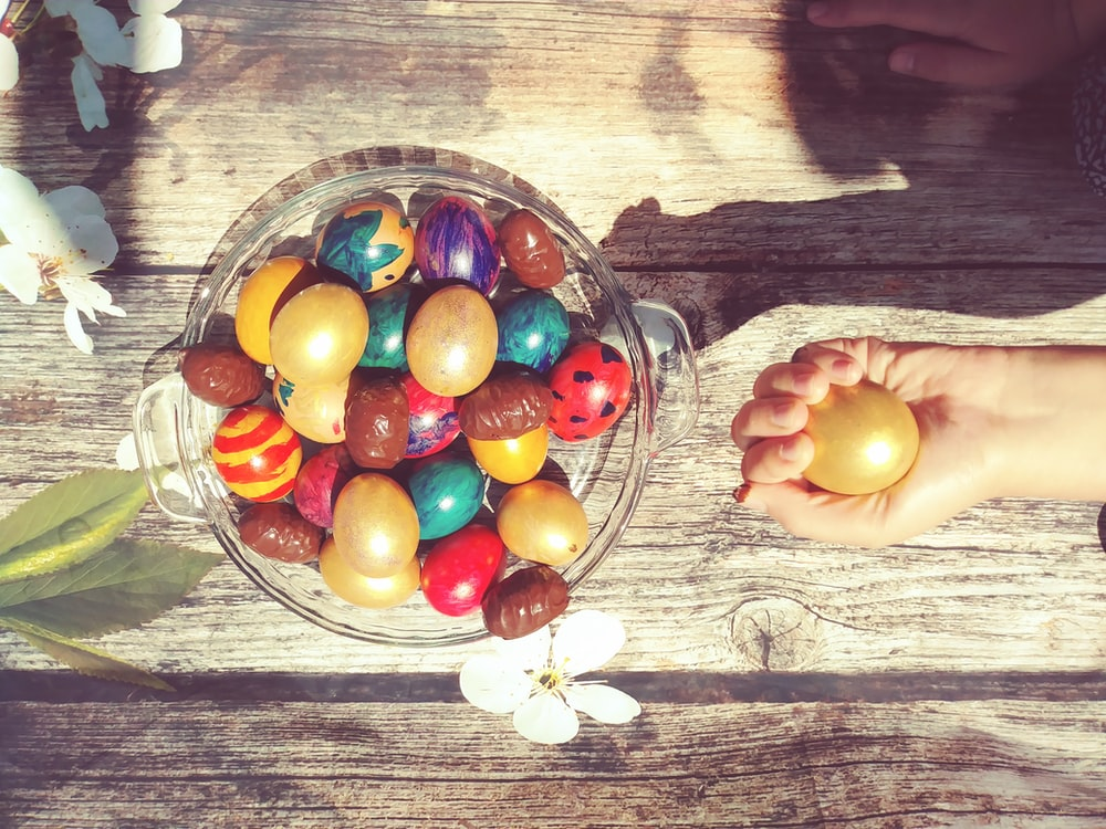 bowl of assorted-color Easter eggs