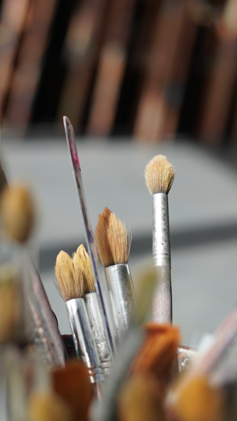 paint brushes on selective focus photography
