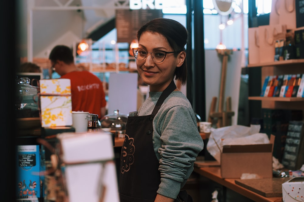 barista standing at the counter