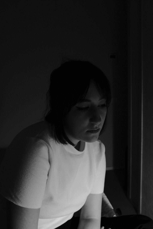 woman wearing white shirt grayscale photo