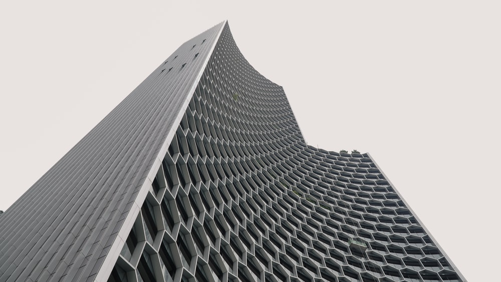 low angle photography of white concrete building during daytime