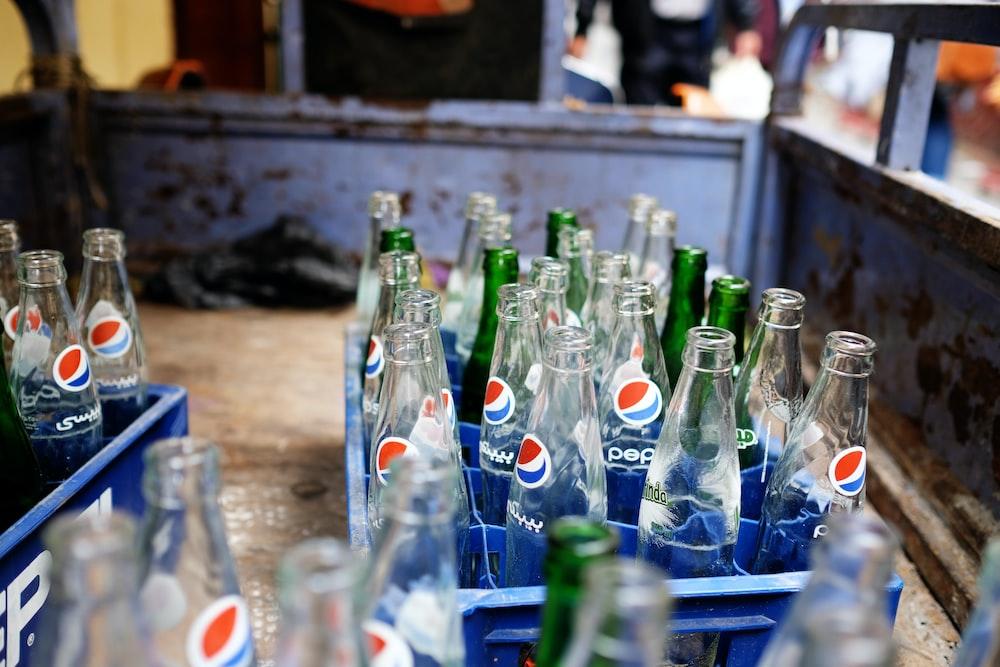 empty pepsi bottles on crates