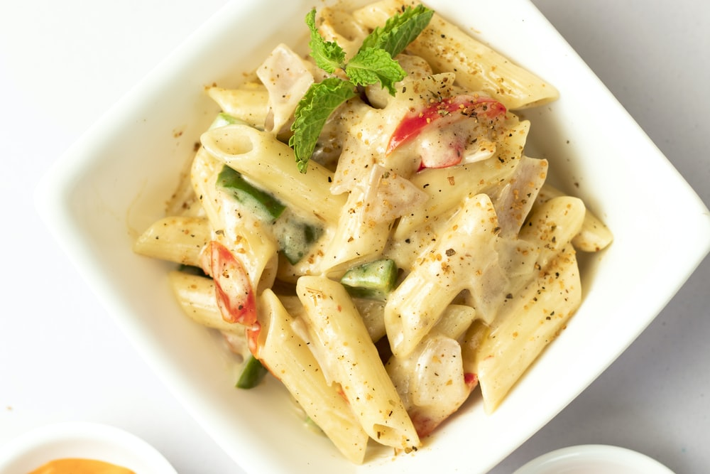 sauced penne pasta dish on bowl