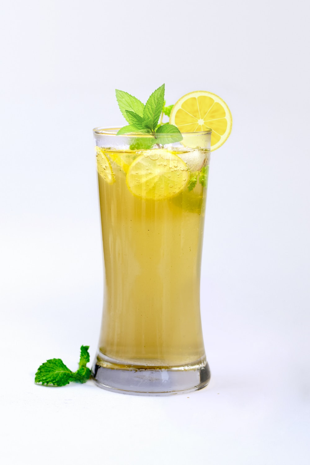 lemon juice in glass with mint herb