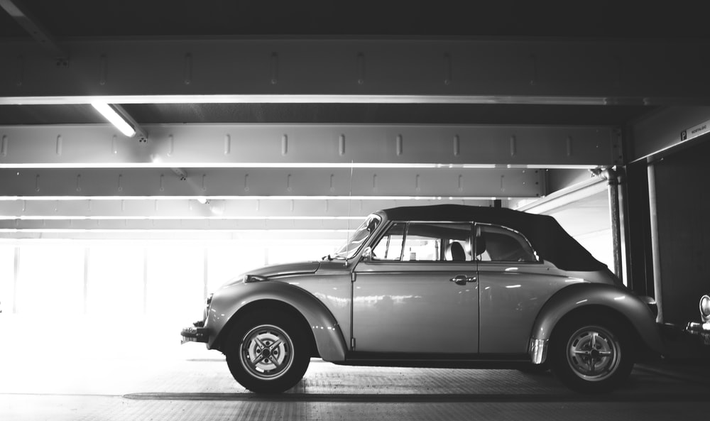 classic Volkswagen Beetle Cabriolet parked in parking lot
