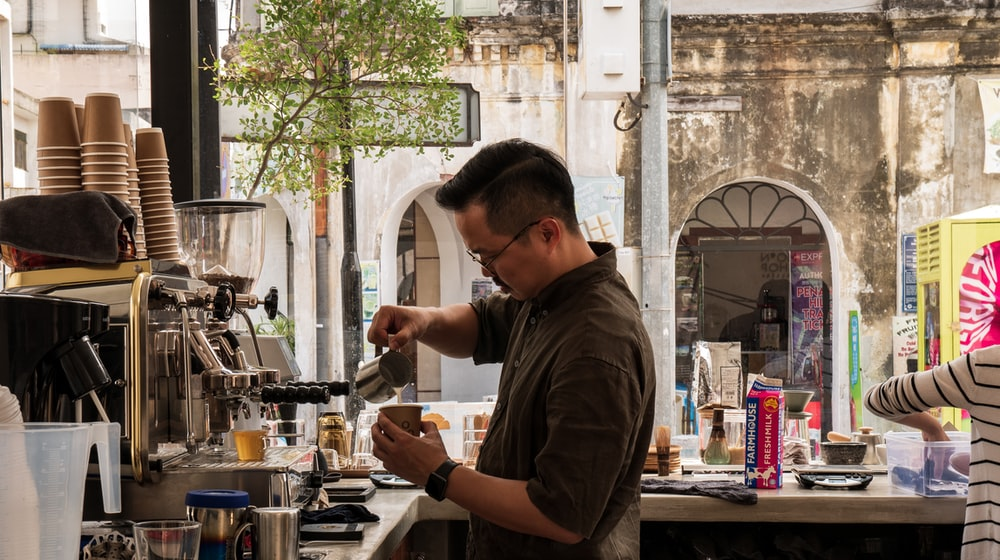 man filling tea cup