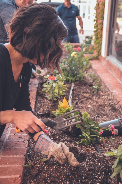 woman holding garden fork