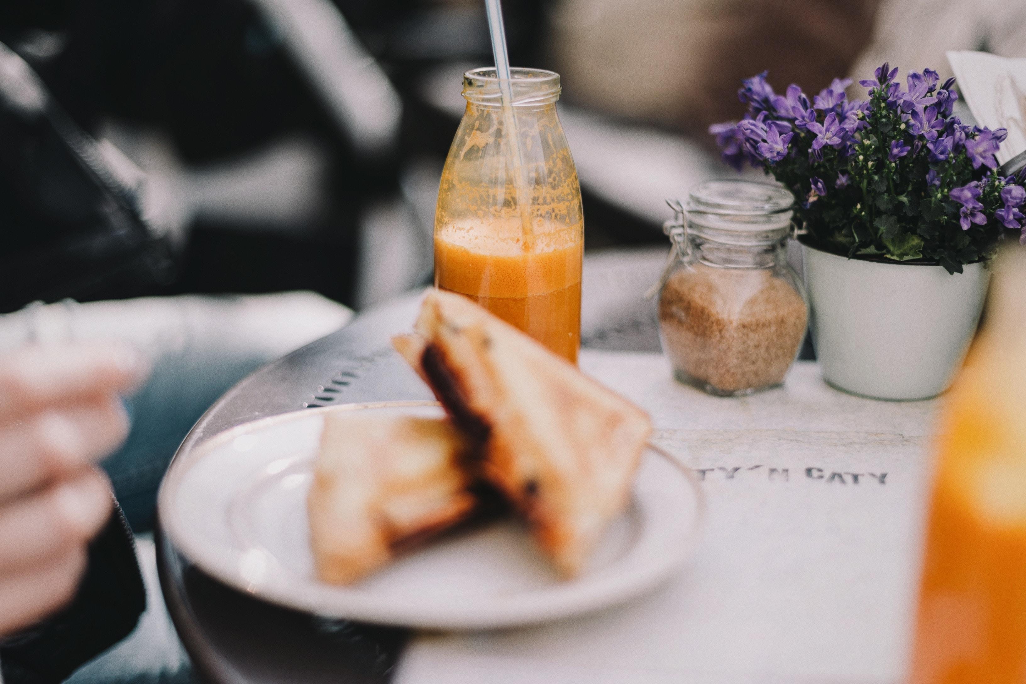toasted bread on plate near bottle