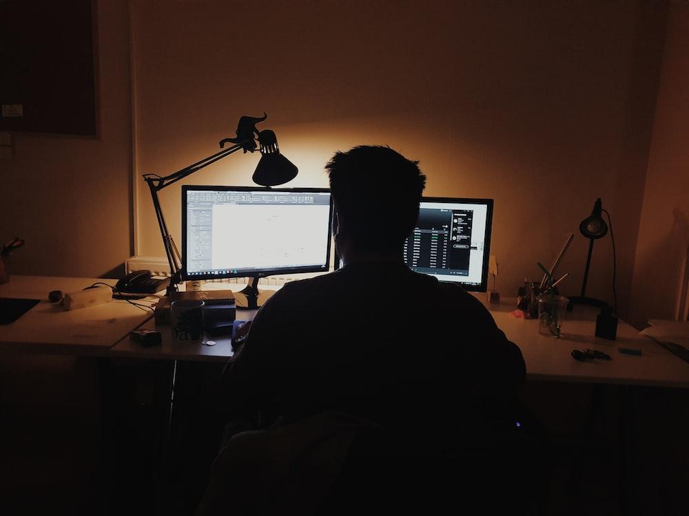 man using computer inside room