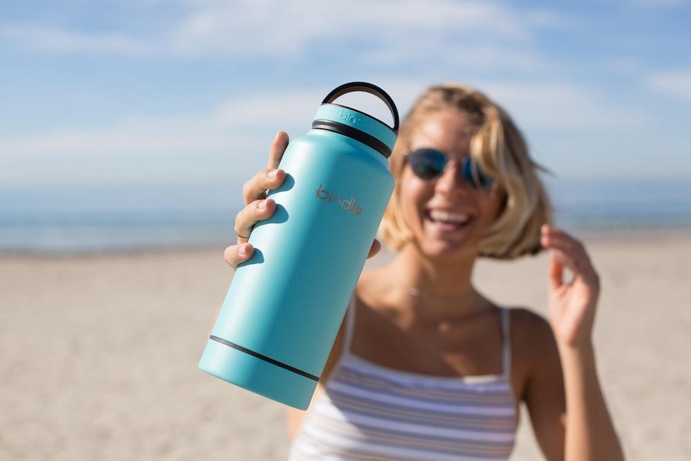 woman holding blue tumbler