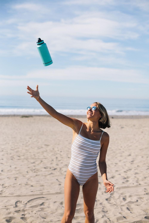 woman throwing blue tumbler