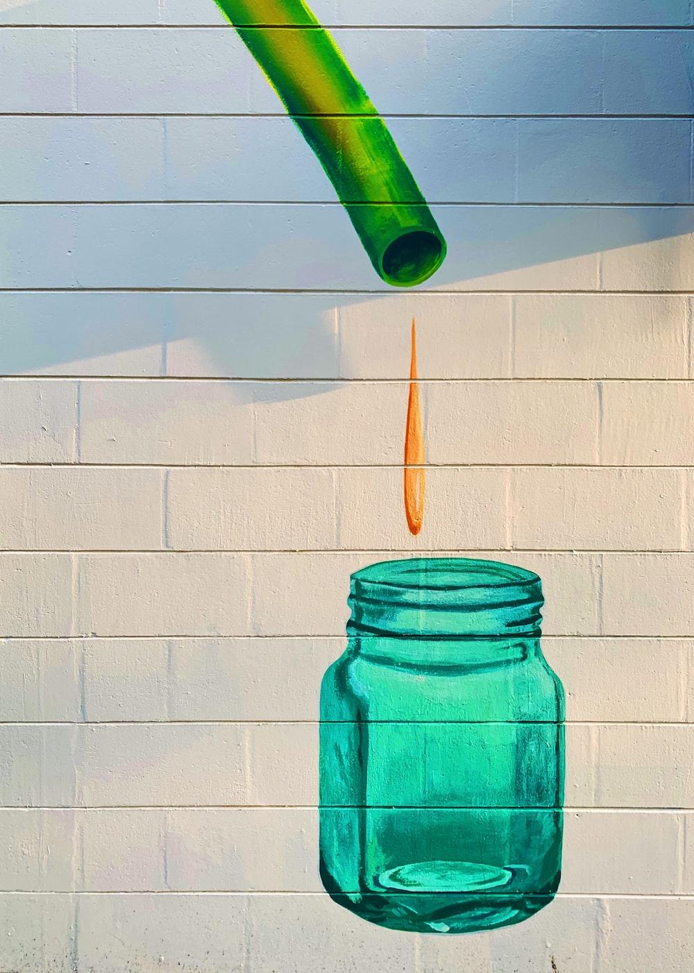 teal printed jar on concrete wall