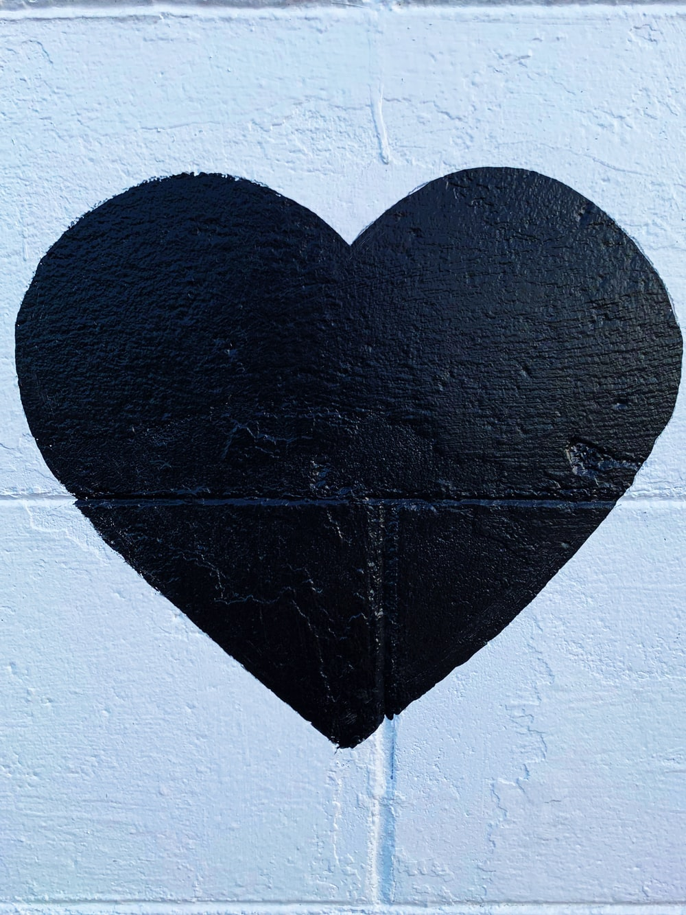 black heart printed concrete wall