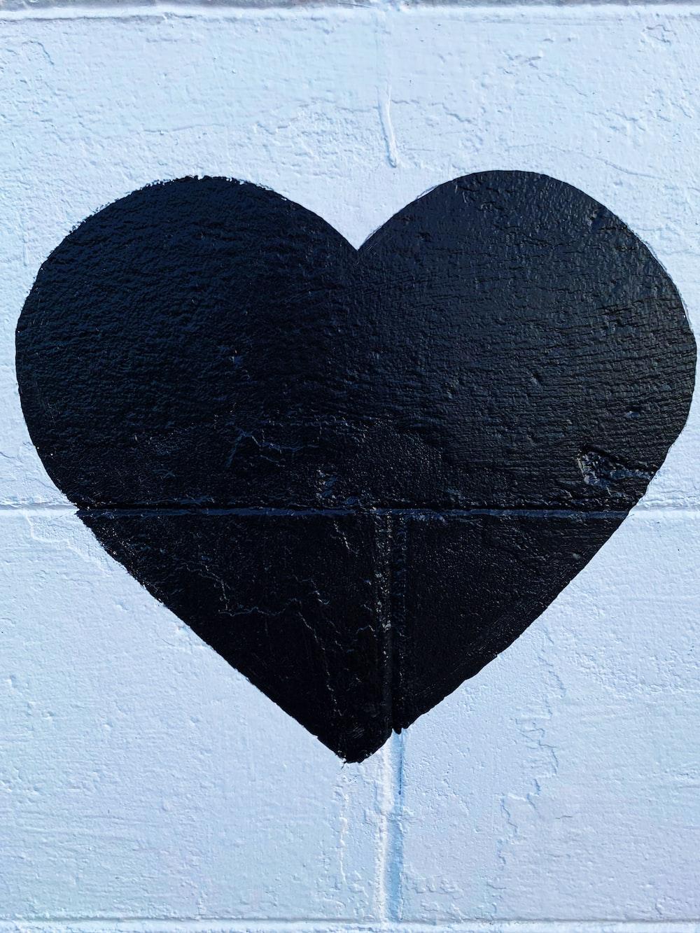 black heart printed concrete wall