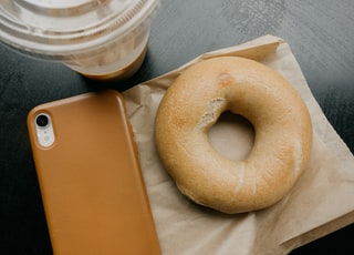 donut beside brown smartphone