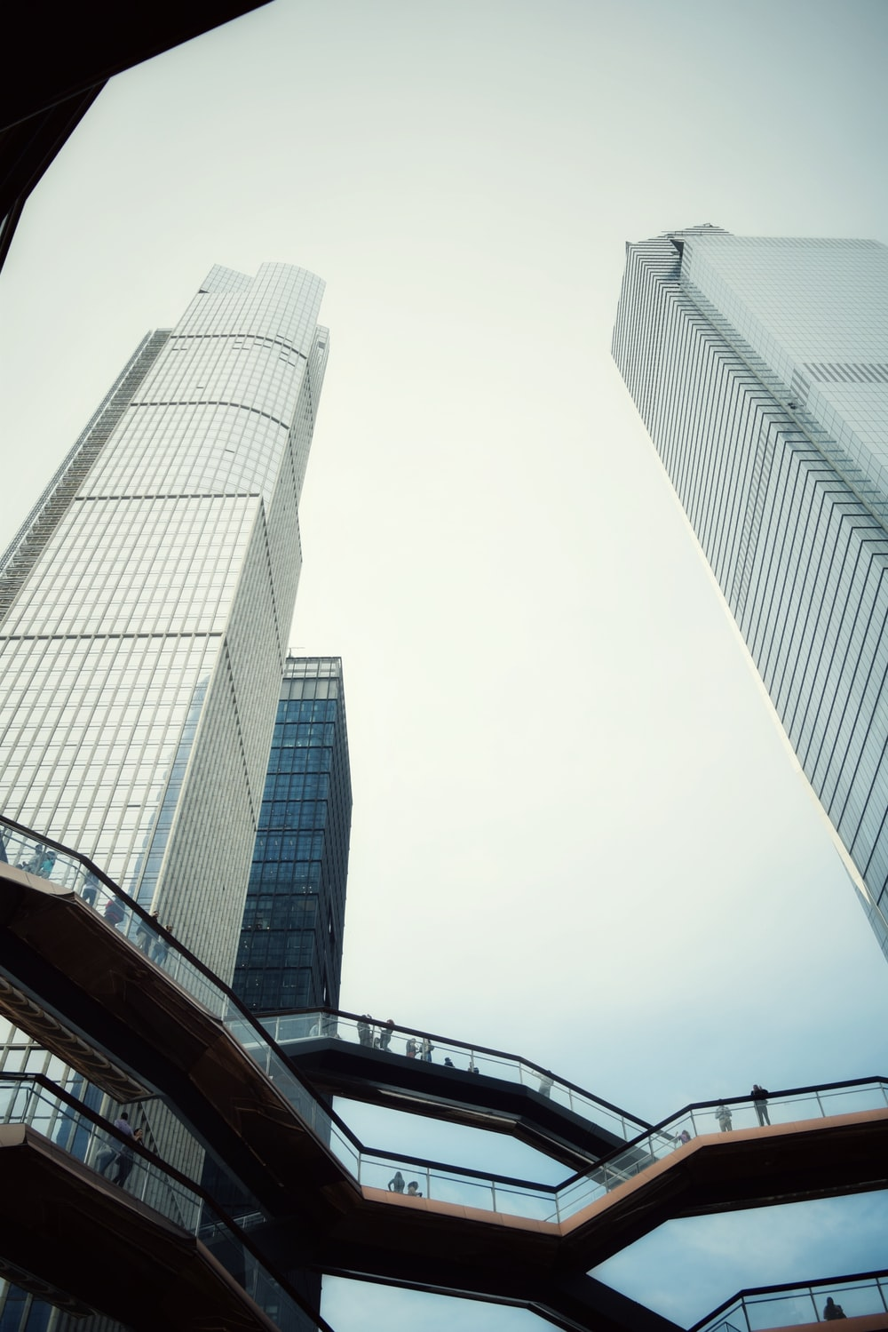 low-angle photo of curtain wall building