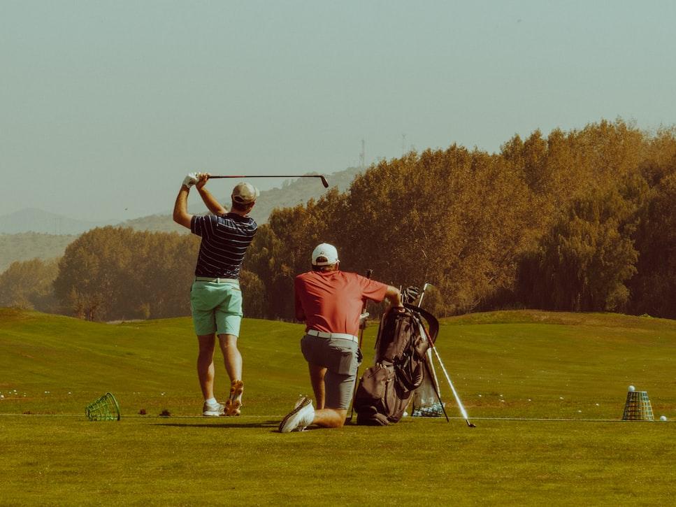 2 men playing golf