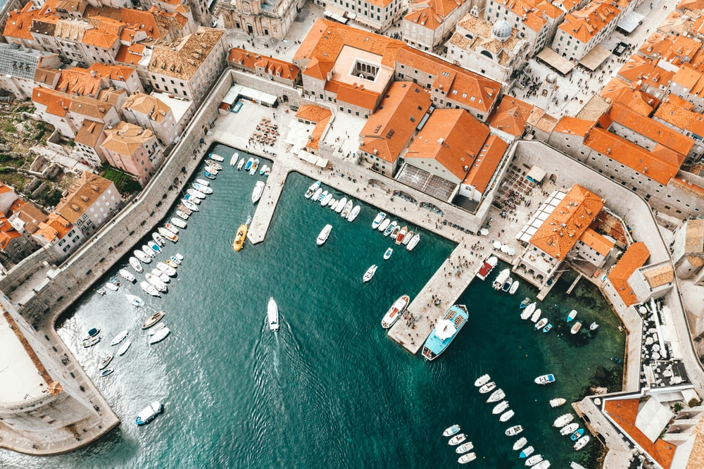aerial photography of boats on pier and city