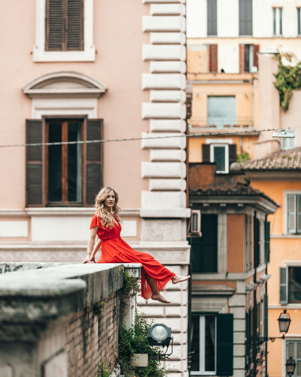 woman sitting on rooftop