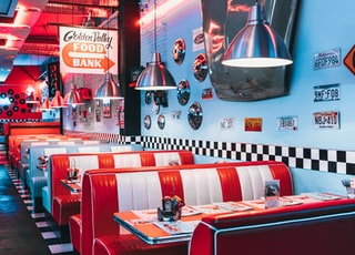 red padded sofa and tables inside building