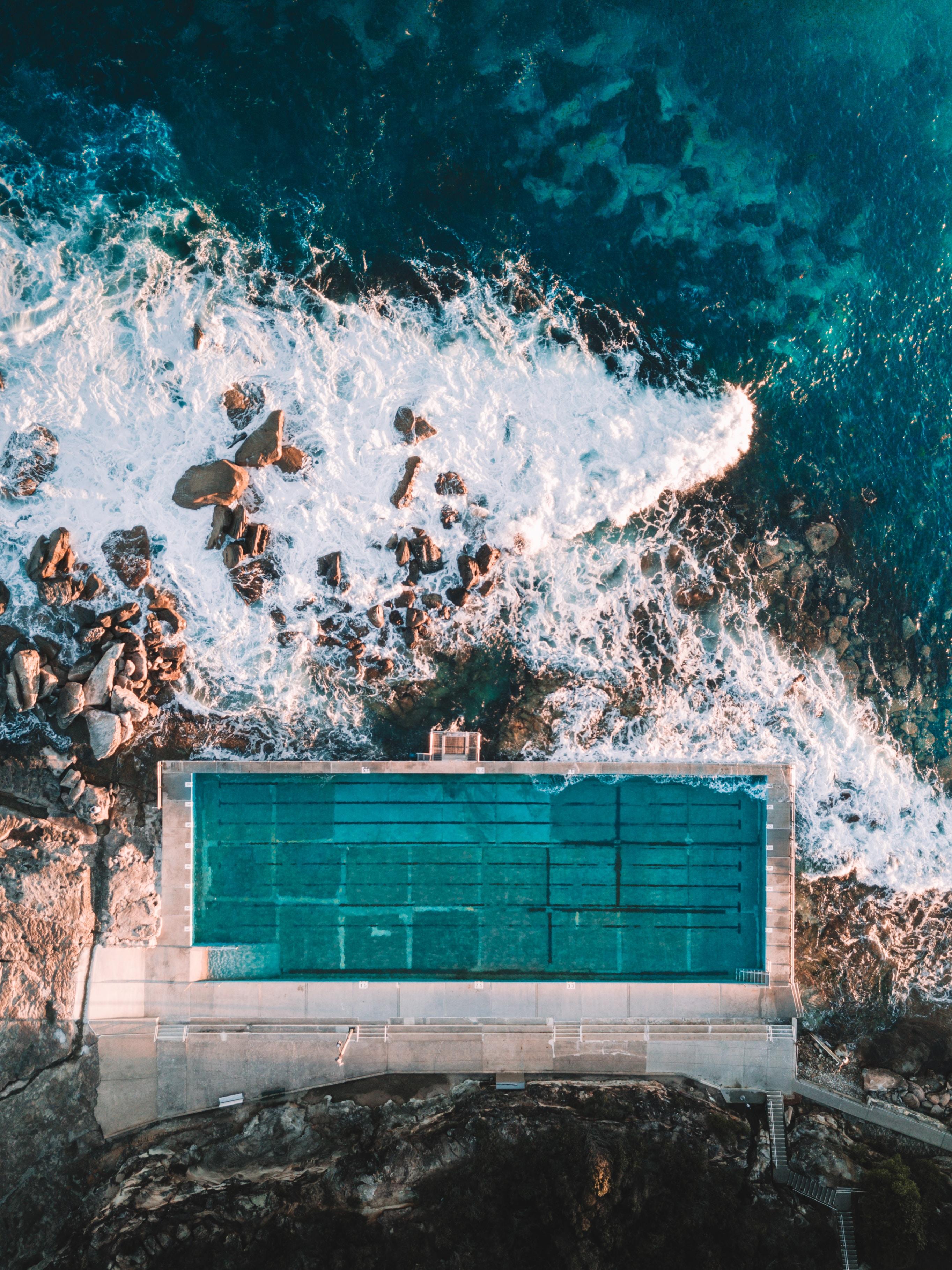 aerial photo of concrete building near sea