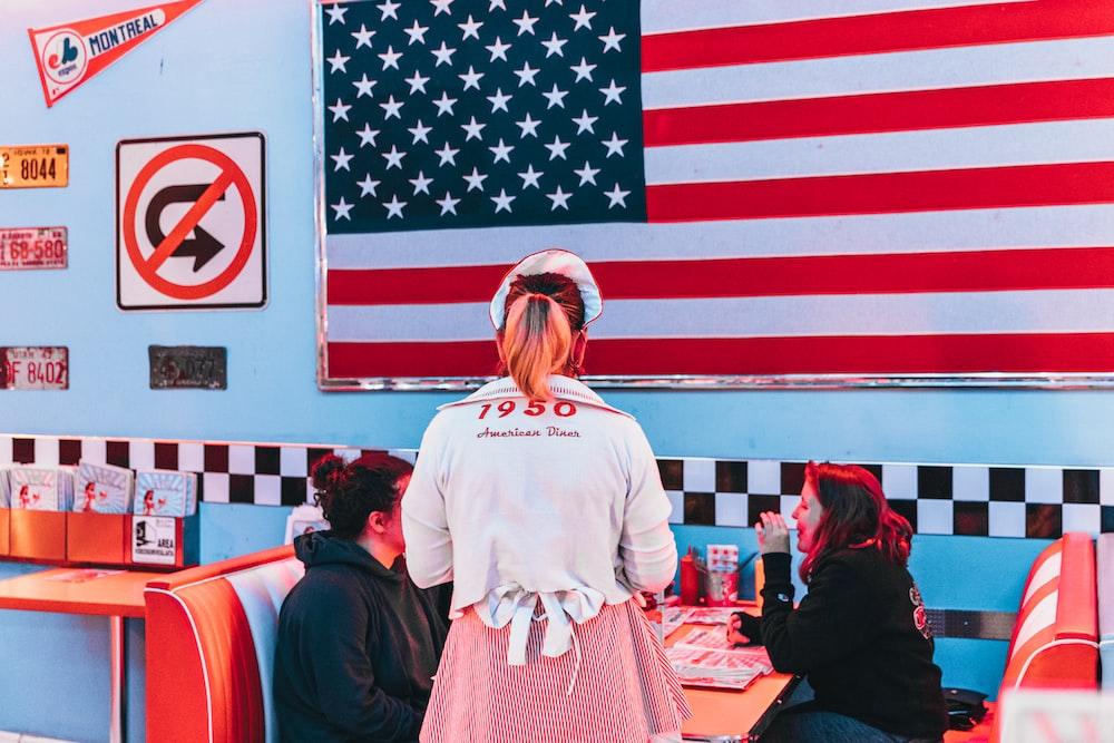 woman standing near USA flag