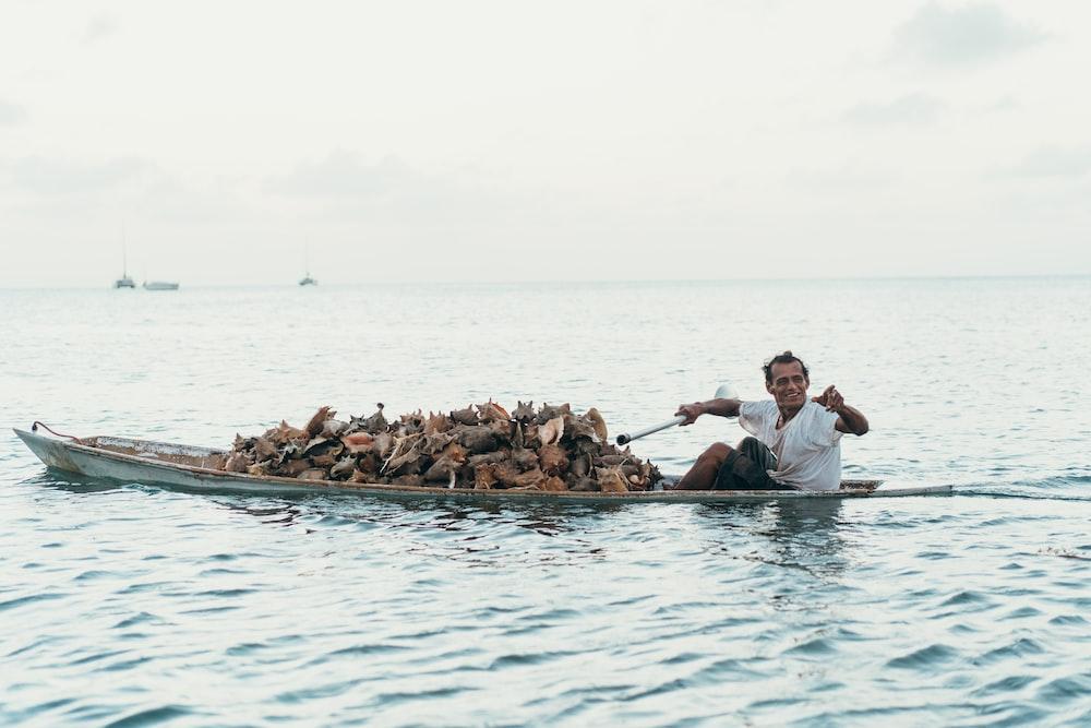 man riding boat during daytime