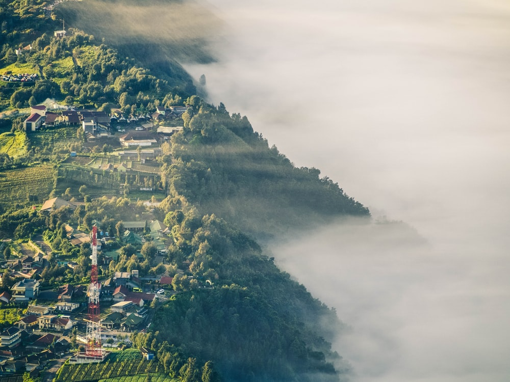 aerial photo of village beside mountain