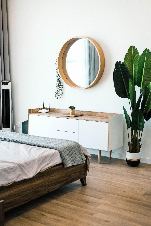 white wooden dresser with mirror