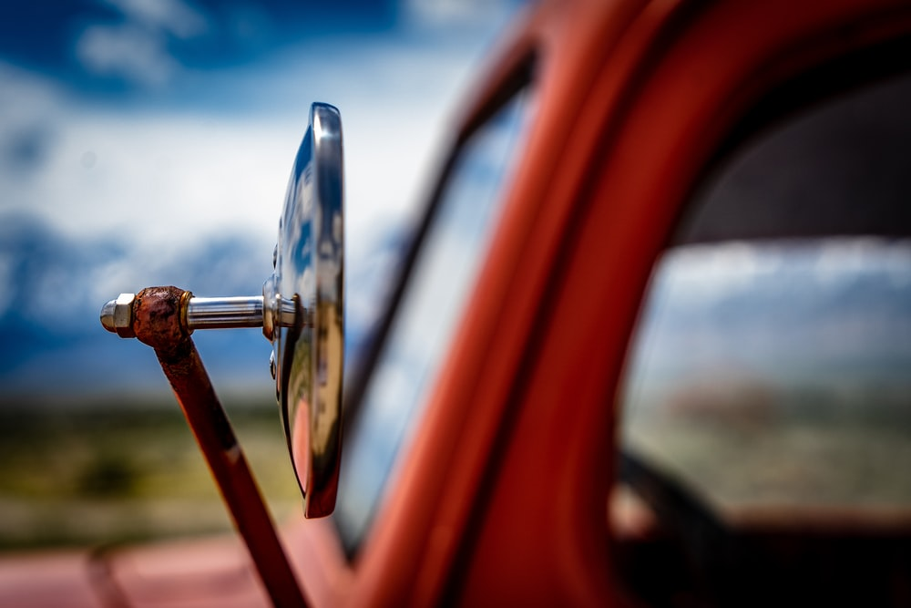 selective focus photography of silver wing mirror