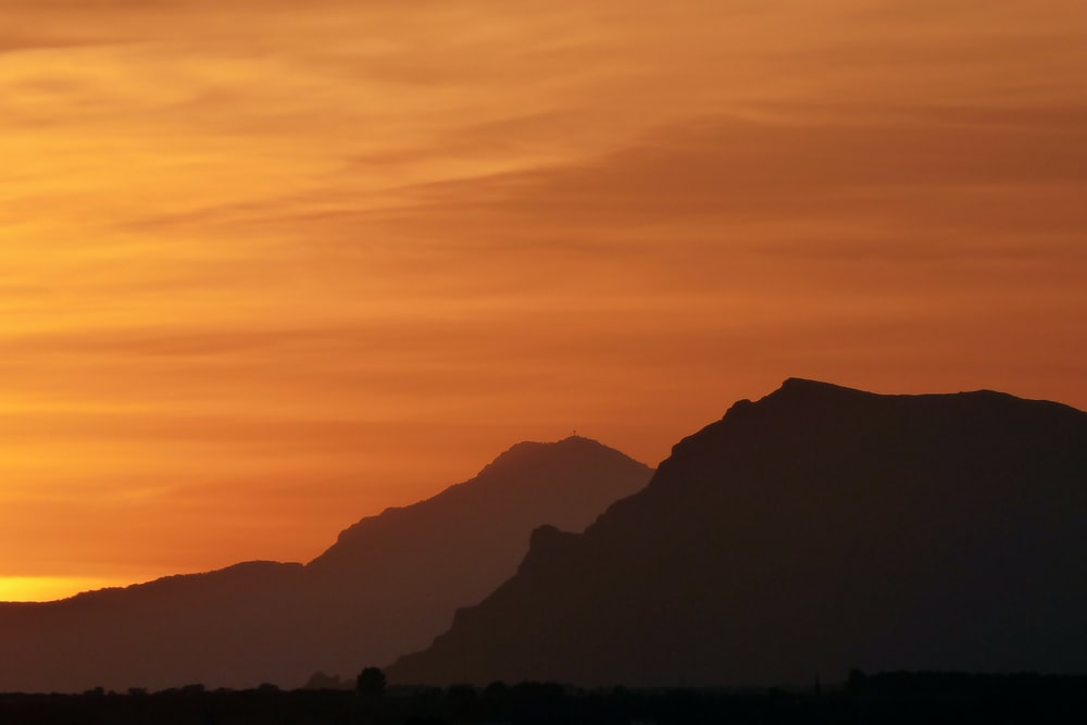 silhouette photography of mountains