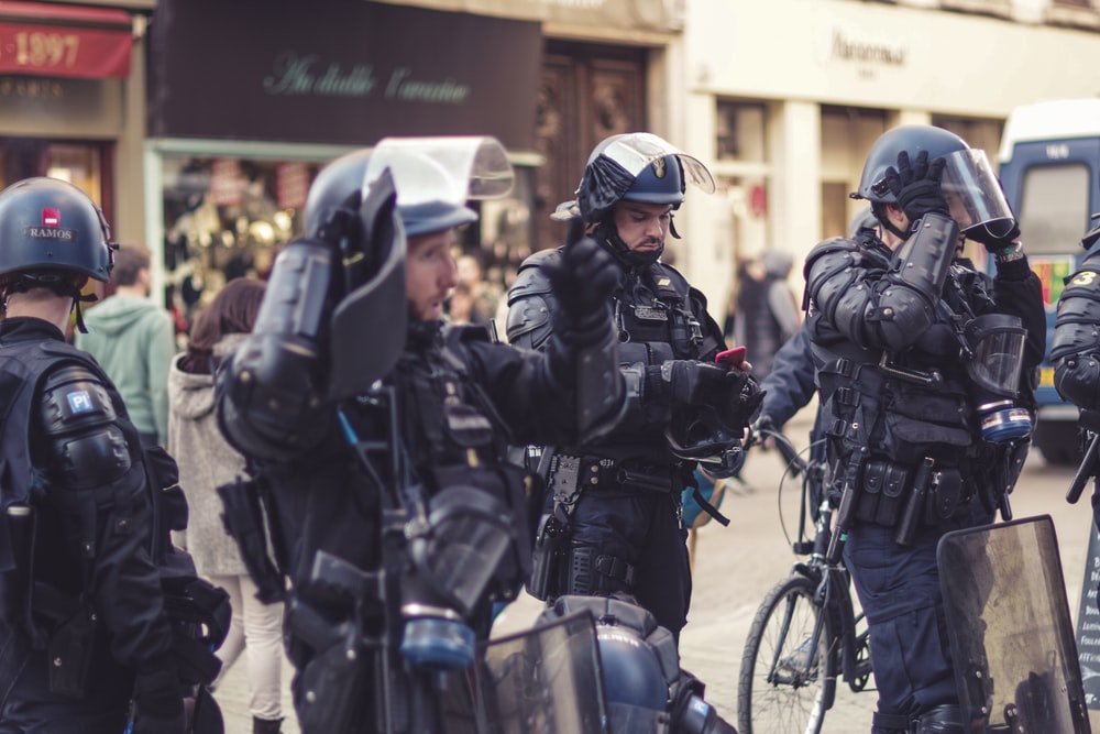police men standing near building