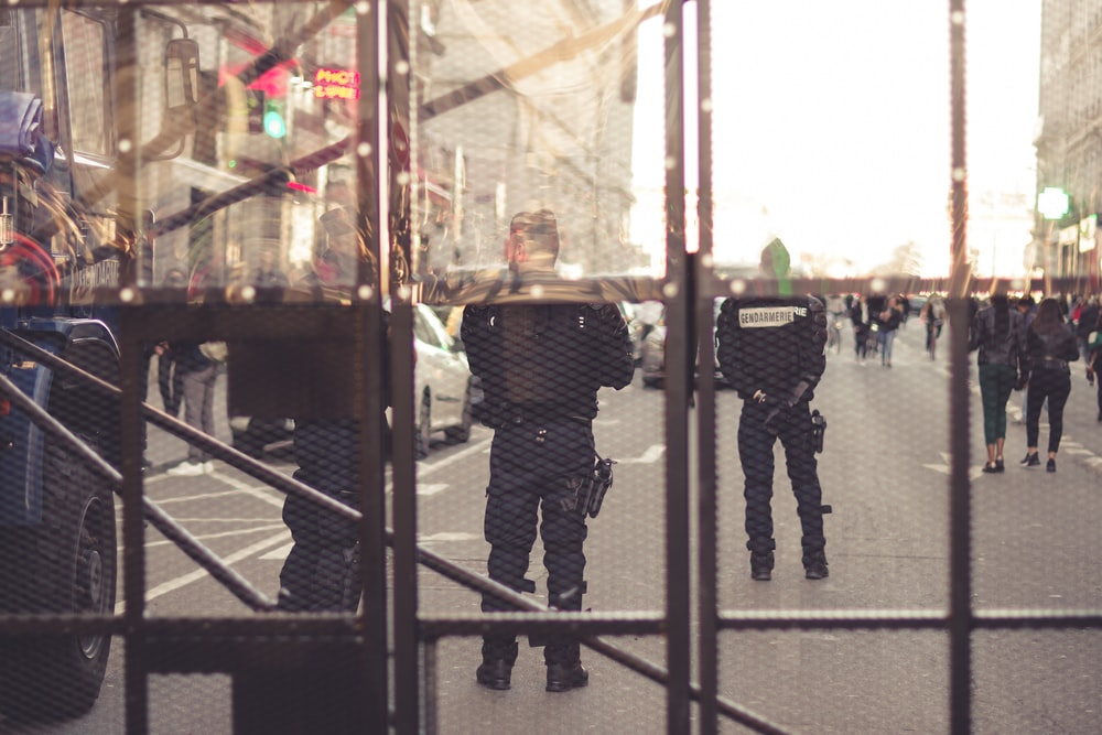 person wearing black police suit