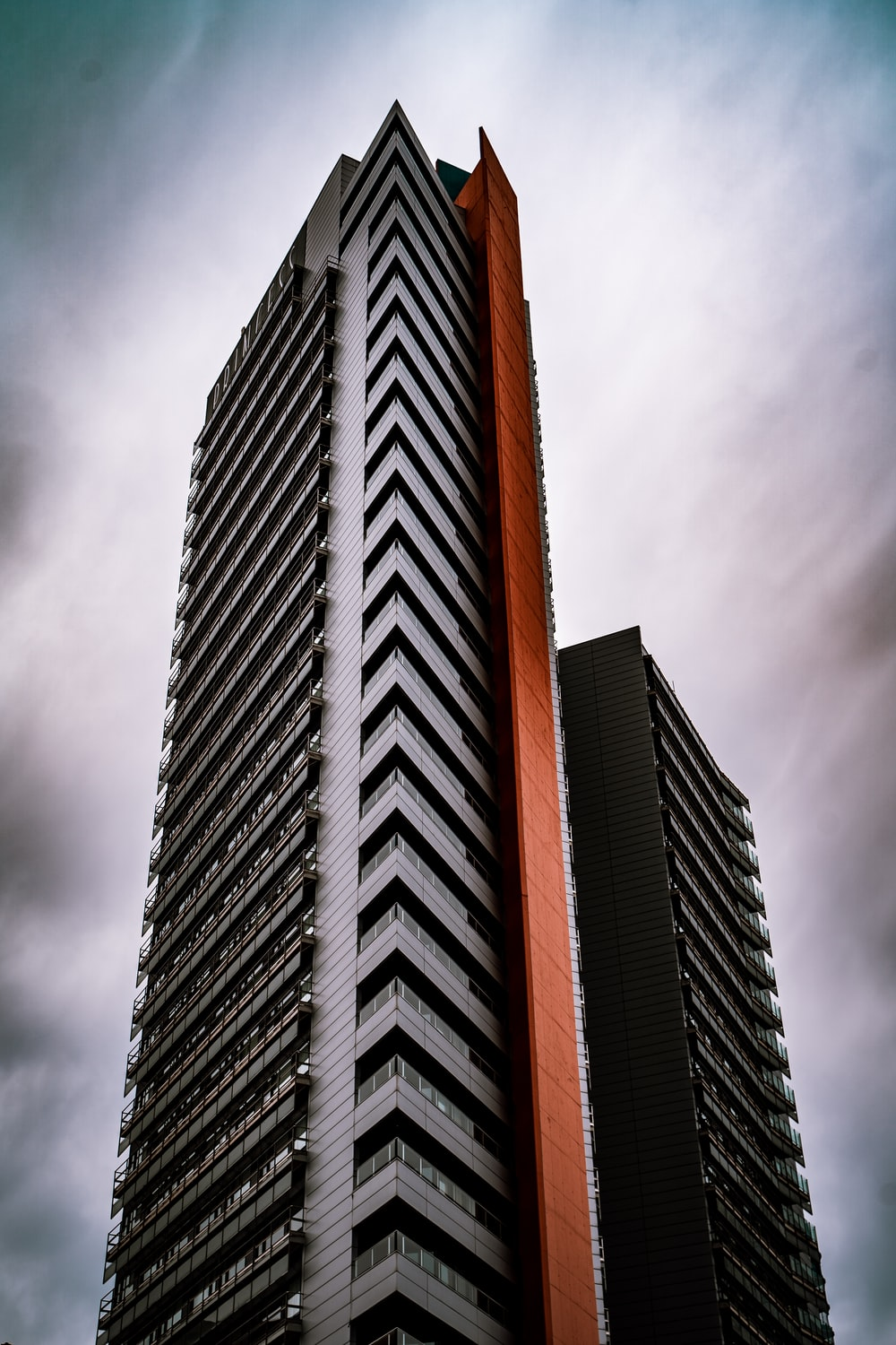 low-angle photo of grey high-rise building