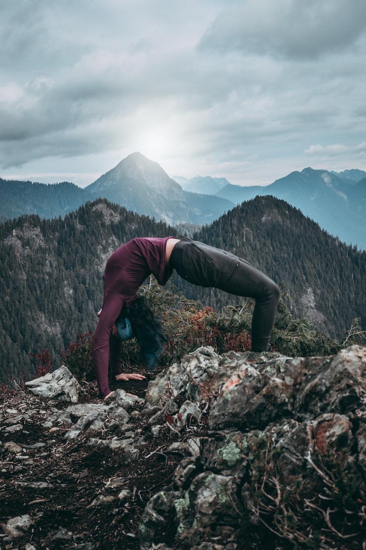 woman back flipping on rocks