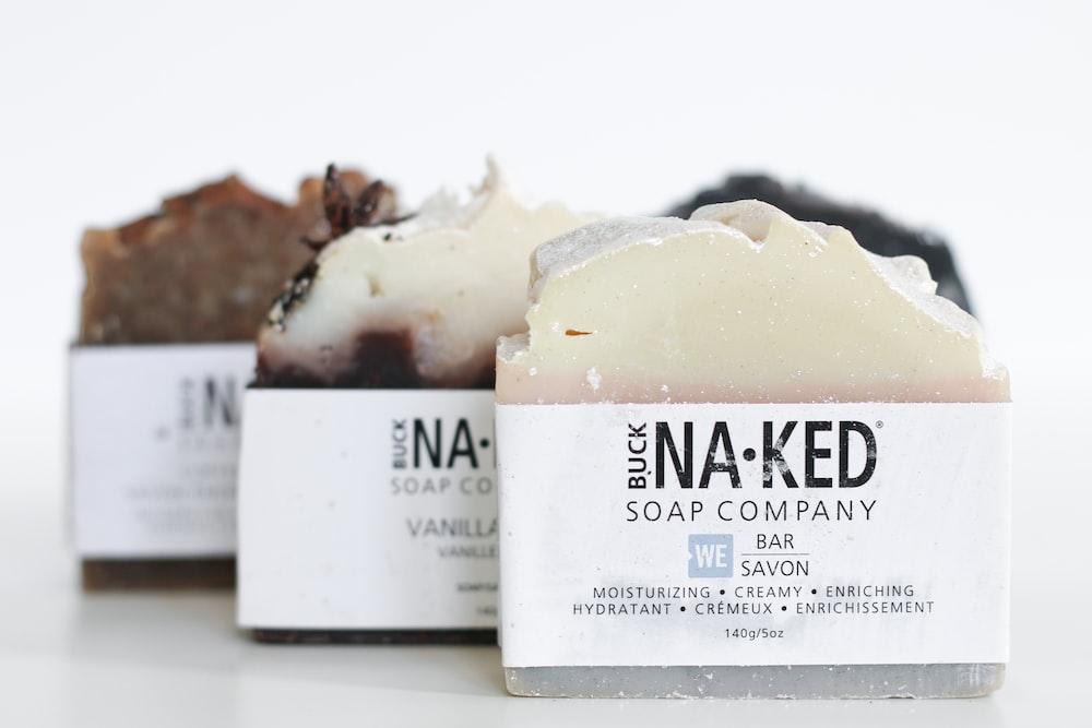 three brown Buck naked soap company