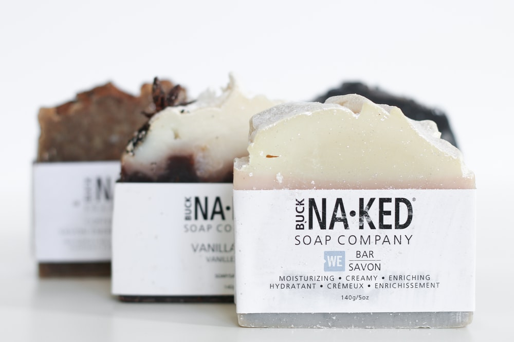 three brown Buck naked soap company