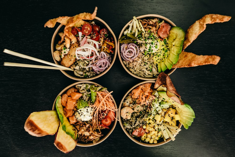 four assorted dishes on bowls