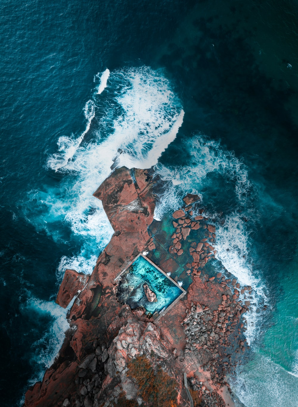 aerial photography of island near ocean
