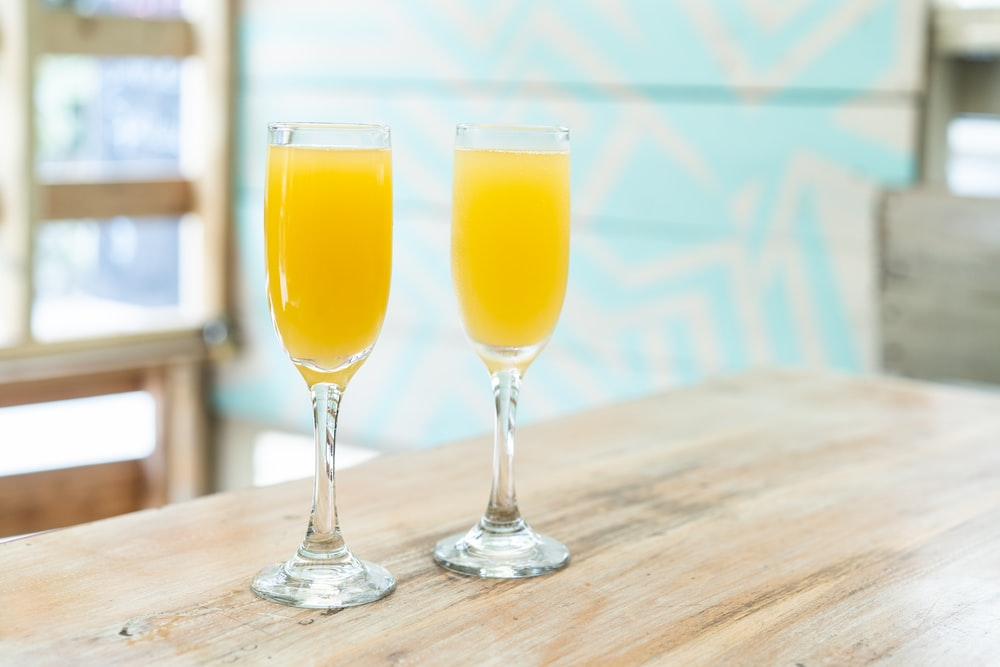 two orange juices on table